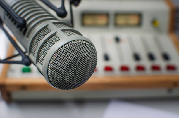 Professional microphone and audio mixer stock photo