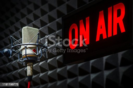 istock Professional Microphone and On air sign 1191199775