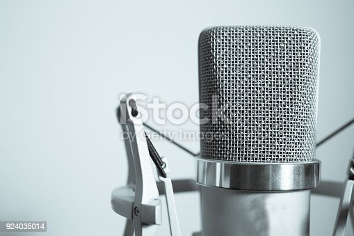 istock Professional microphone silver on white background 924035014
