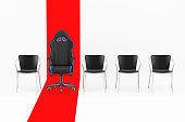 istock Professional Modern Black and Blue Computer Gaming Armchair in Row with Simple Chairs over Red Line. 3d Rendering 1252699467