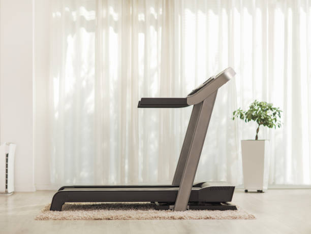 Professional modern treadmill at home Shot of a professional modern treadmill at home treadmill stock pictures, royalty-free photos & images