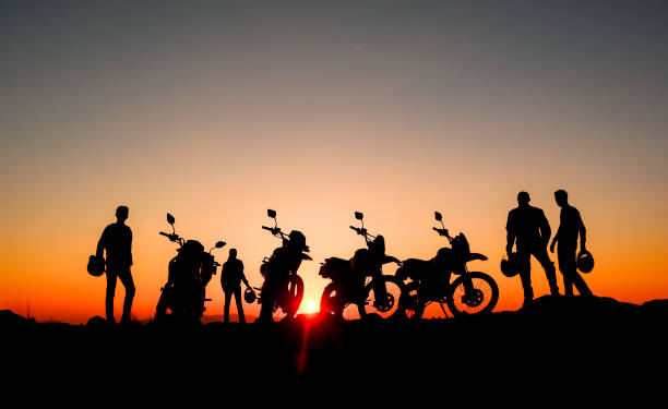 professional motorcyclist and reconnaissance tours - motorcycle stock photos and pictures