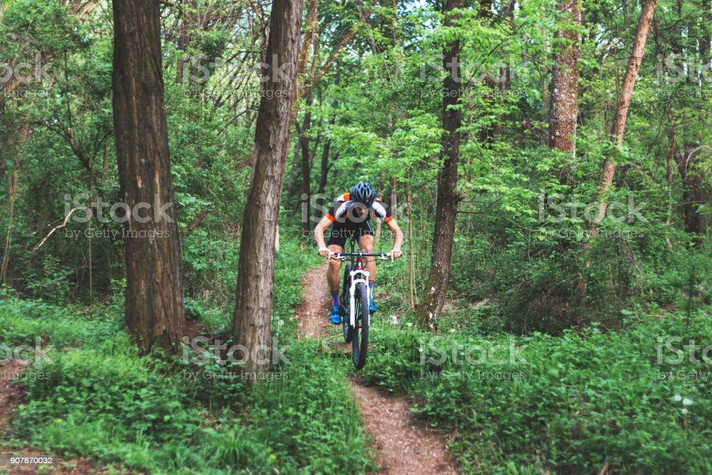 Professional mountain biker on track stock photo