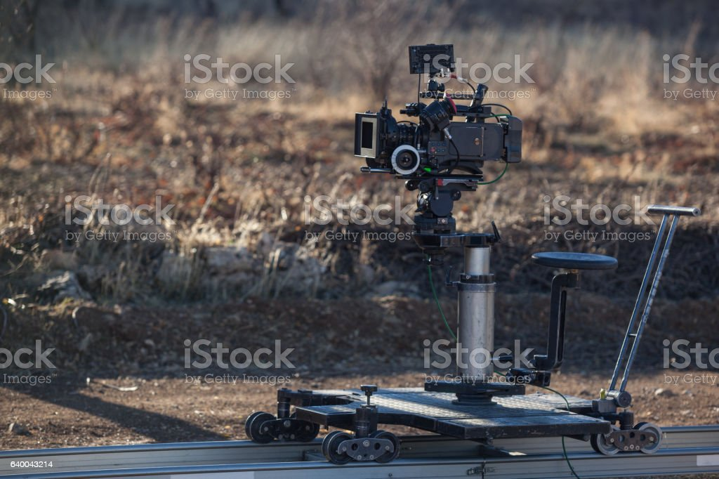 Professional Movie Camera On Dolly In Outdoor stock photo