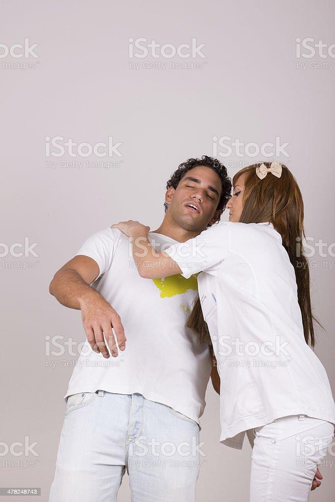 professional nurse holding sick fainting man stock photo