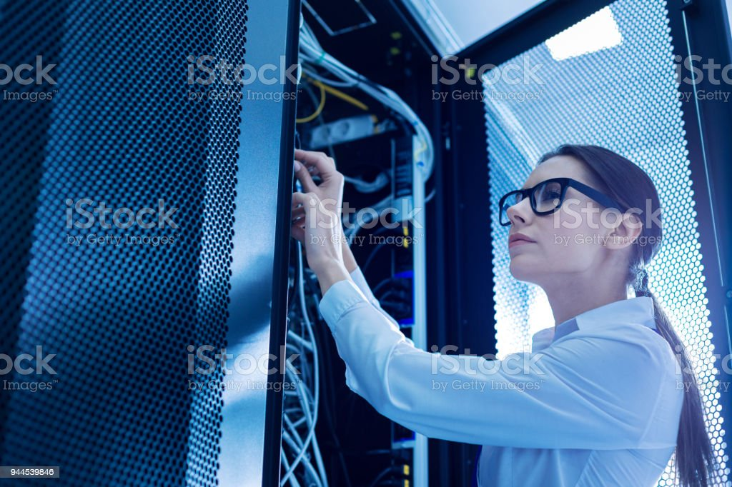Professional operator fixing important wires stock photo