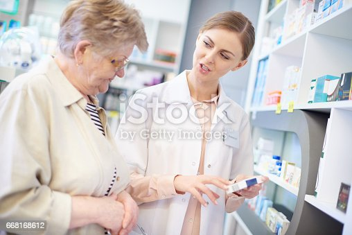 istock Professional pharmacist explaining prescription 668168612