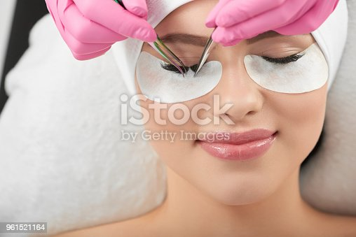 istock Professional photo of smiling model lying during lasmkaing process. 961521164