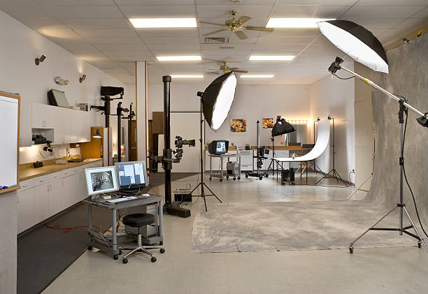 Professional Photo Studio with computer and lighting stock photo