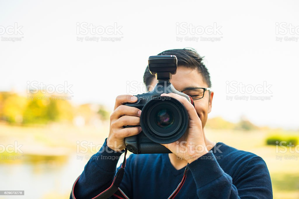 Professional Photographer taking a photo stock photo