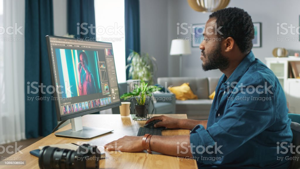 Professional Photographer Works in Photo Editing App / Software on His Personal Computer. Photo Editor Retouching Photos of Beautiful Girl. Mock-up Software Design. stock photo