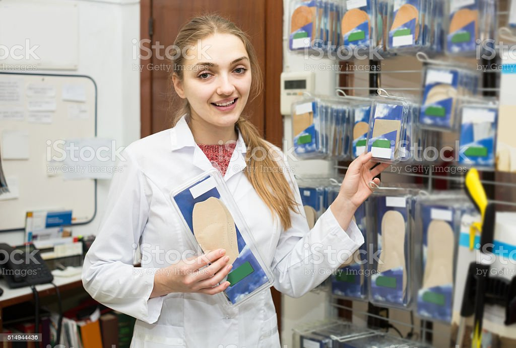 professional physician offering orthopaedic insoles in special s stock photo