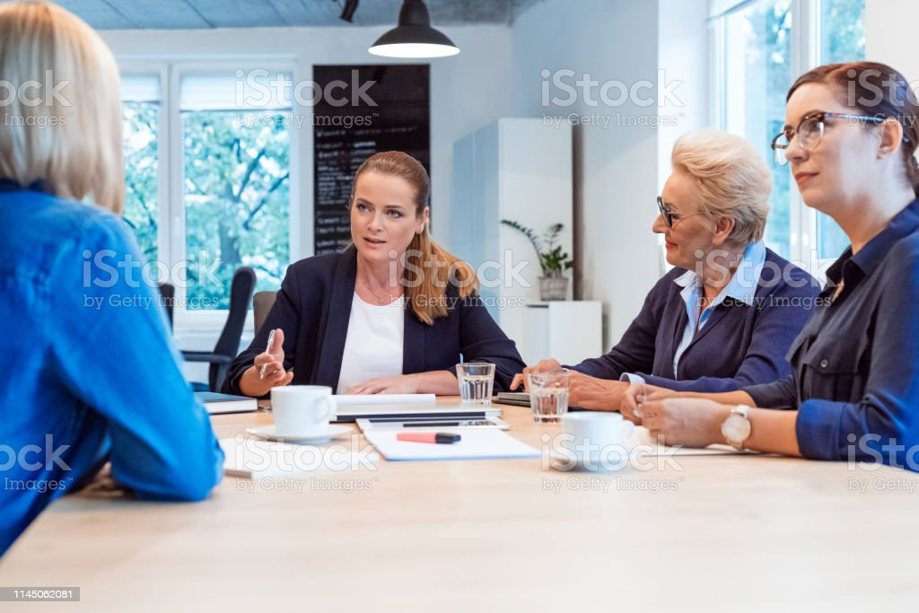 Professional planning with colleagues in meeting Female professional planning strategy with colleagues. Businesswomen are discussing in board room. They are running new business. 35-39 Years Stock Photo