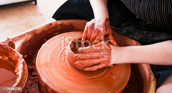 529137622 istock photo Professional potter making bowl in pottery workshop 1129150782