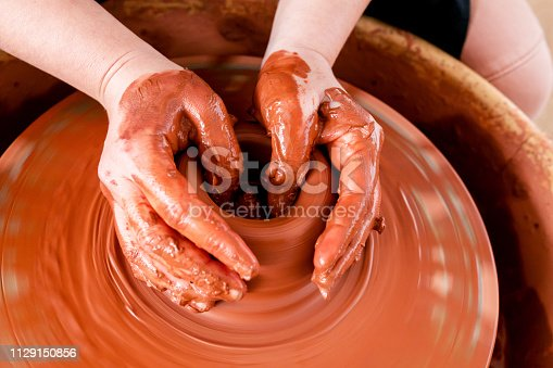529137622 istock photo Professional potter making bowl in pottery workshop 1129150856