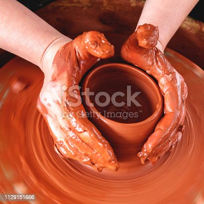 529137622 istock photo Professional potter making bowl in pottery workshop 1129151666