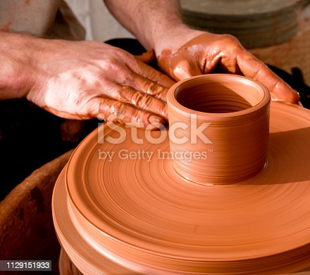 529137622 istock photo Professional potter making bowl in pottery workshop 1129151933