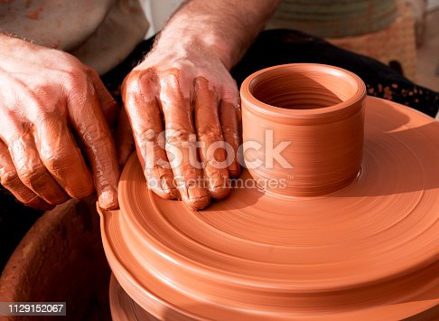 529137622 istock photo Professional potter making bowl in pottery workshop 1129152067
