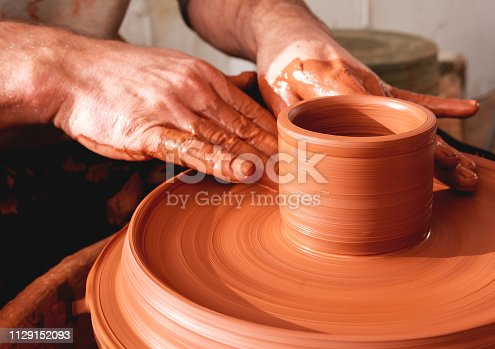 529137622 istock photo Professional potter making bowl in pottery workshop 1129152093