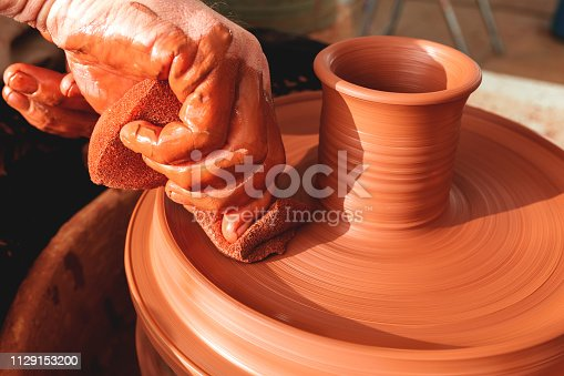 529137622 istock photo Professional potter making bowl in pottery workshop 1129153200