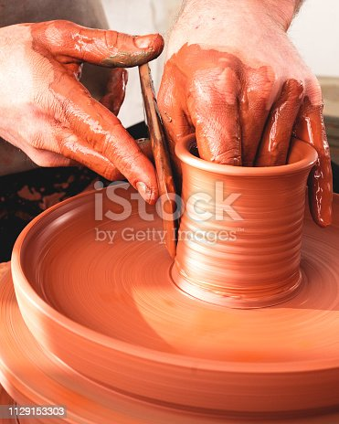 529137622 istock photo Professional potter making bowl in pottery workshop 1129153303