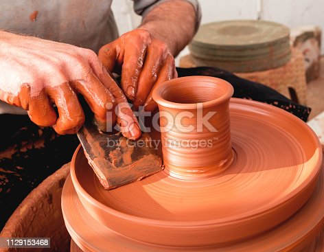 529137622 istock photo Professional potter making bowl in pottery workshop 1129153468
