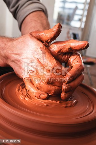 istock Professional potter making bowl in pottery workshop 1129153575