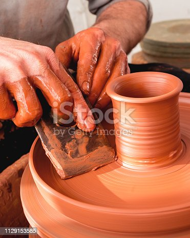 istock Professional potter making bowl in pottery workshop 1129153585