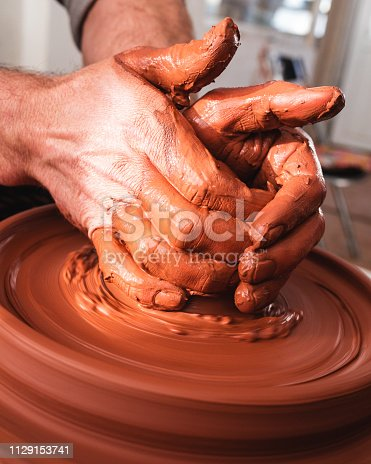 529137622 istock photo Professional potter making bowl in pottery workshop 1129153741