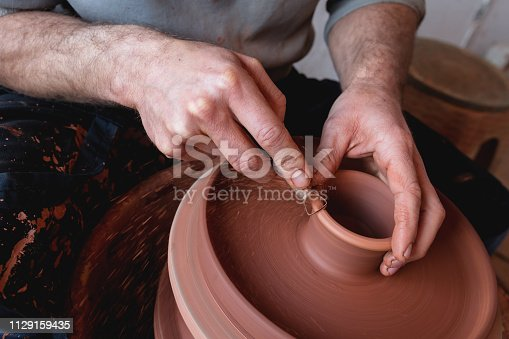 529137622 istock photo Professional potter making bowl in pottery workshop 1129159435