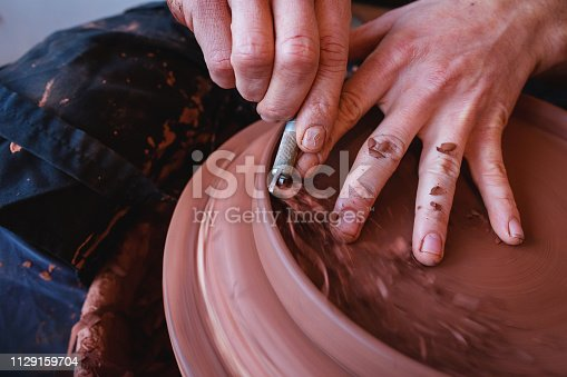 529137622 istock photo Professional potter making bowl in pottery workshop 1129159704