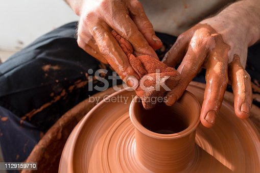 529137622 istock photo Professional potter making bowl in pottery workshop 1129159710