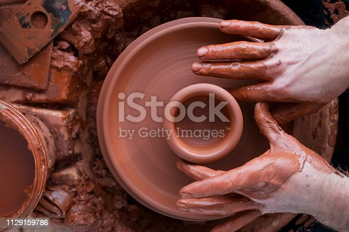 529137622 istock photo Professional potter making bowl in pottery workshop 1129159786