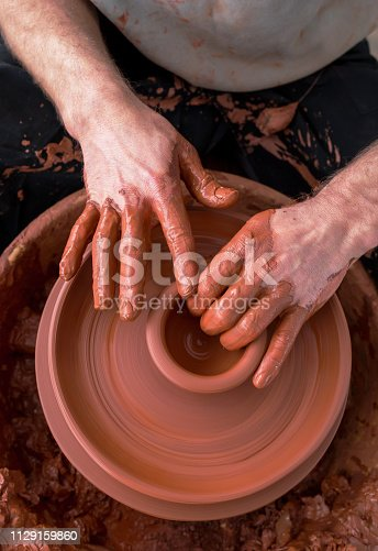 istock Professional potter making bowl in pottery workshop 1129159860