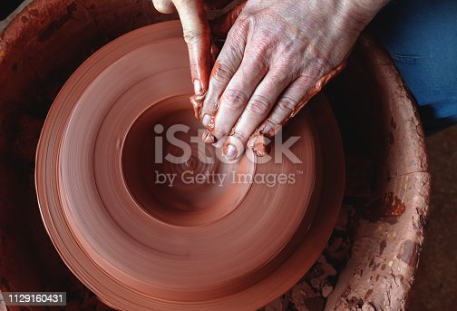 529137622 istock photo Professional potter making bowl in pottery workshop 1129160431