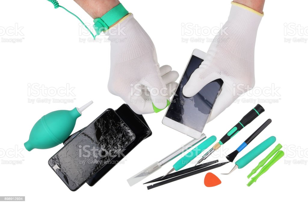 Professional repair of the  modern phones in the european service center. Technican uses the ESD antistatic gloves and wristband. stock photo