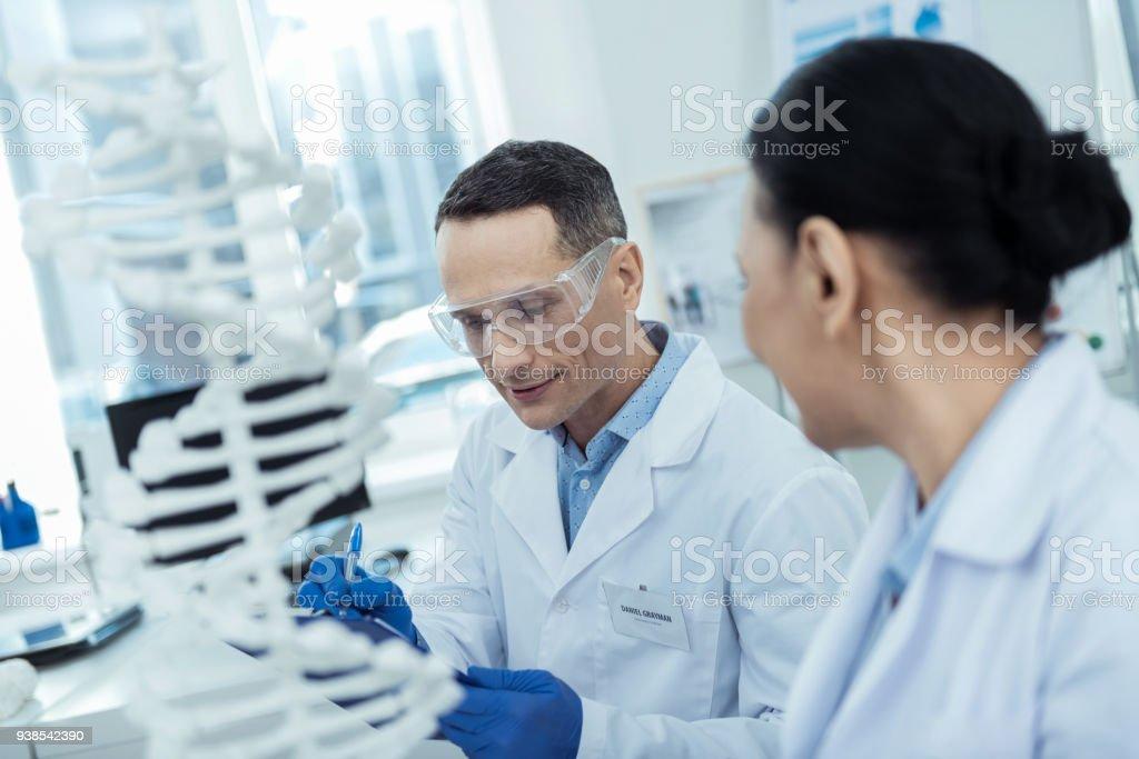Professional reserchers studying bioengineering stock photo