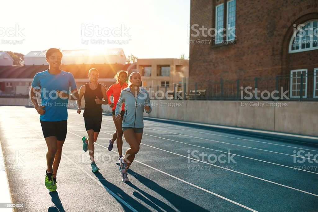 Professional runners running on a race track stock photo