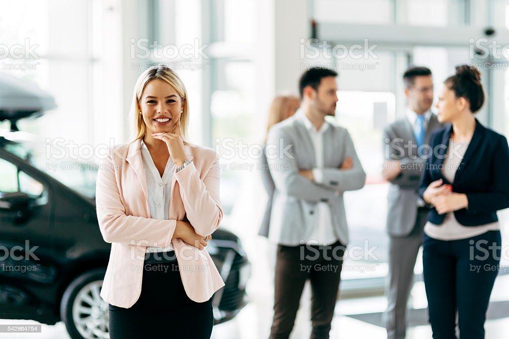 Professional saleswoman at dealership stock photo