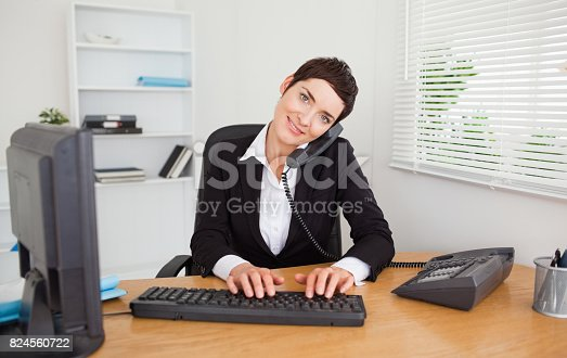 istock Professional secretary answering the phone 824560722