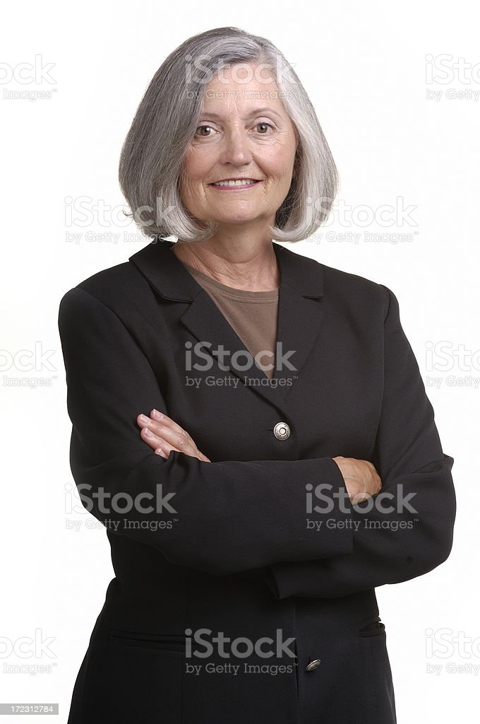 Professional senior woman with arms crossed royalty-free stock photo