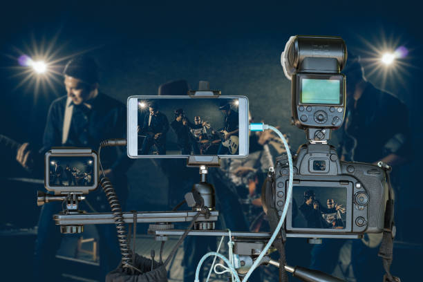 professional set of camera with smart mobile phone and action camera on tripod over musician band holding the microphone singing a song and playing music instrument,live streaming for musical concept - filming stock pictures, royalty-free photos & images