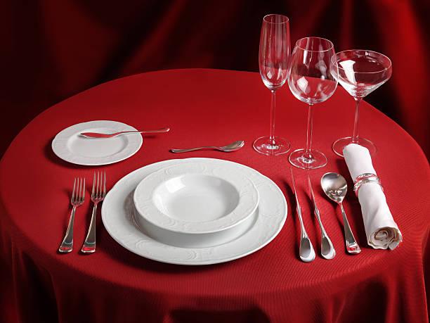 professional setting of red dinner table - bordsskick bildbanksfoton och bilder