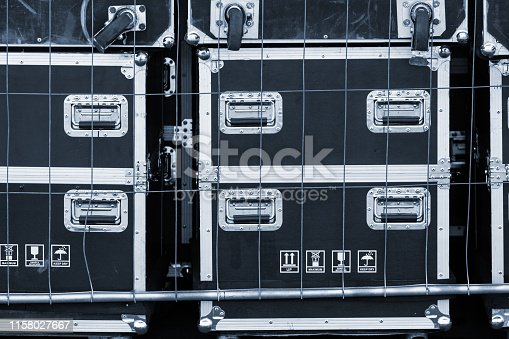 istock Professional shockproof boxes for transportation of concert stage equipment: light, sound, musical instruments. Storage, delivery, installation of equipment for shows and concerts 1158027667