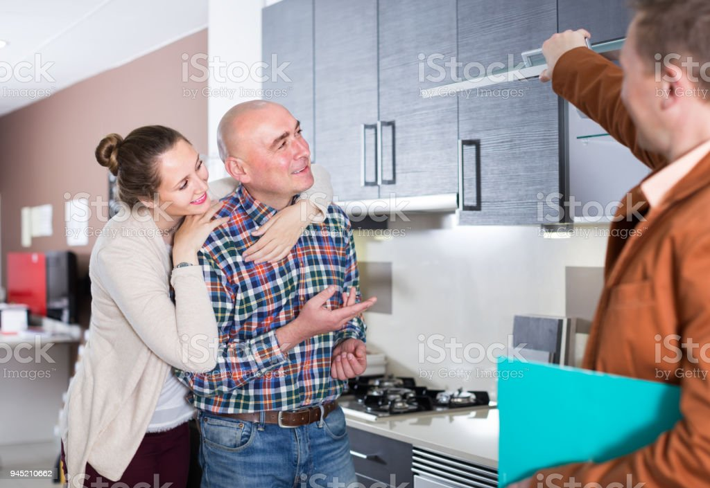 professional shop assistant working with customer in store stock photo