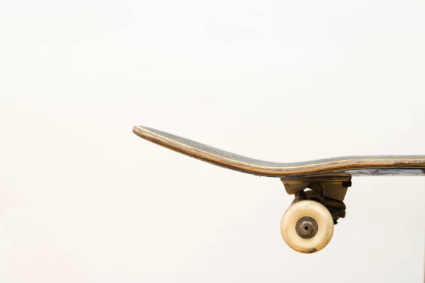 Professional skateboard on white background side view, deck, complete setup, truck, deck, wheels stock photo
