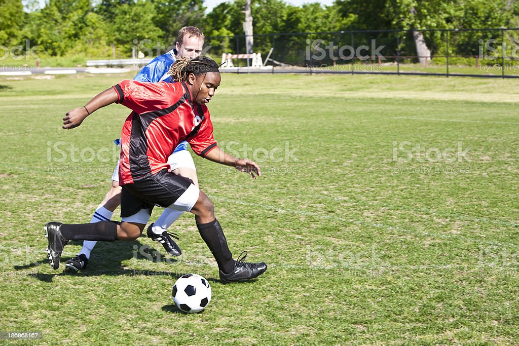 Professional Soccer Player Dribbling the Ball Against Opponent royalty-free stock photo