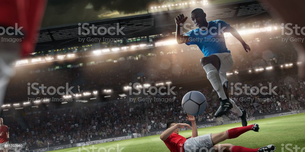 Professional Soccer Player Jumping Over Rival Player During Football Match stock photo