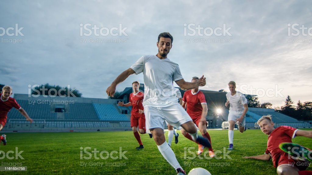 Professional Soccer Player Outruns Members of Opposing Team and Kicks...