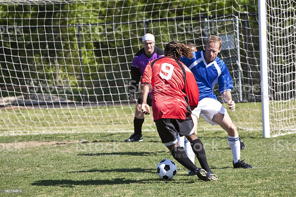 Professional Soccer Player Trying to Score a Goal stock photo